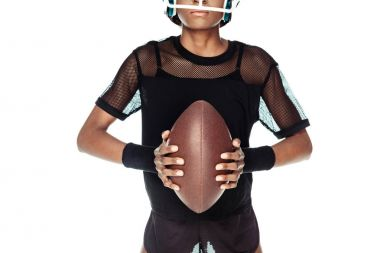 cropped shot of female american football player with ball isolated on white