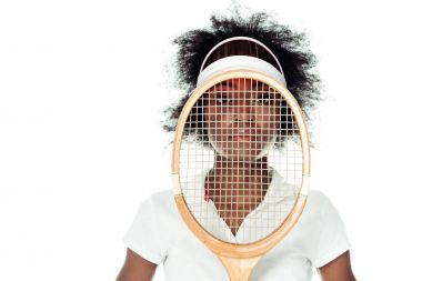 female tennis player with racket in front of face isolated on white