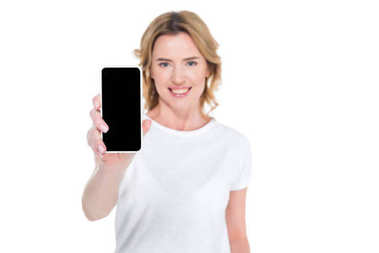 Portrait of smiling woman showing smartphone with blank screen isolated on white stock vector