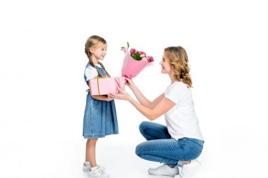 mother and daughter with present and bouquet of flowers, isolated on white