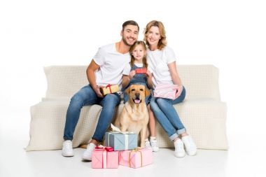 happy family and dog sitting on sofa with gifts, isolated on white