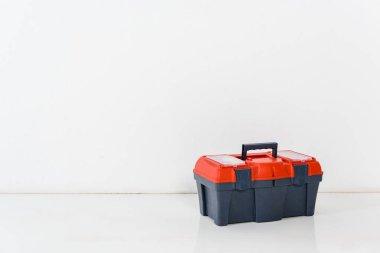one tools box on white floor