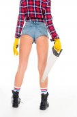 back view of sexy girl in gloves holding saw, isolated on white