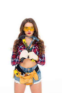 Beautiful girl in goggles and gloves with tool belt holding hammers, isolated on white stock vector