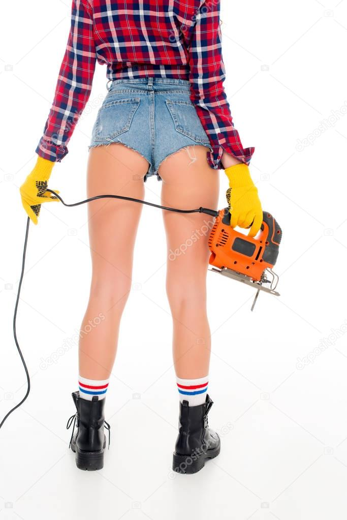 back view of sexy girl with electric fret saw, isolated on white