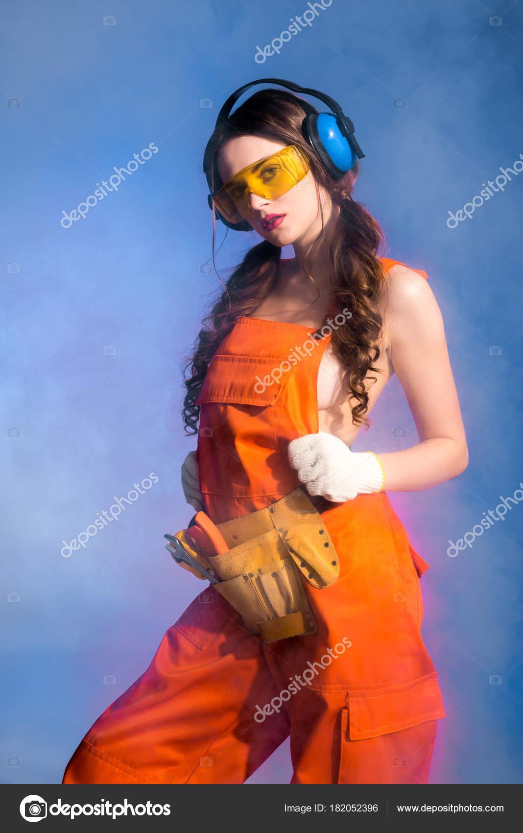 beautiful sexy girl overalls tool belt goggles protective headphones