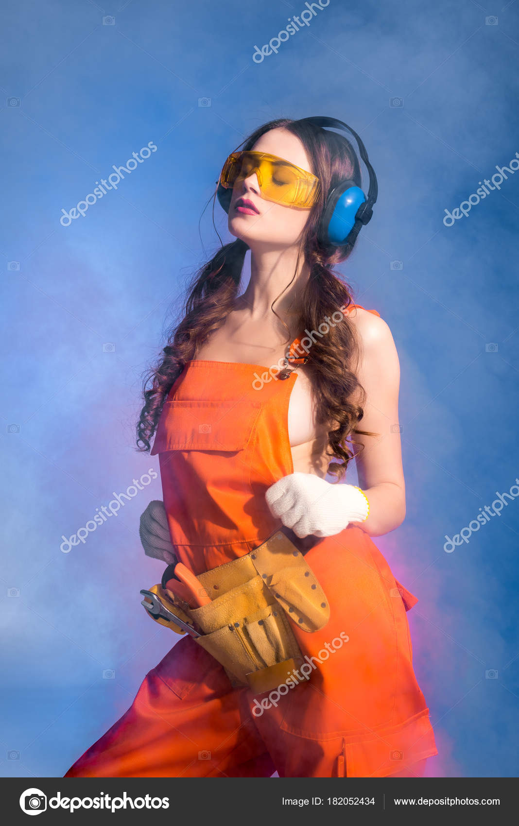 sexy girl overalls tool belt goggles protective headphones isolated