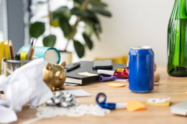 close up view of soda drink, party decorations and notebook on tabletop in office