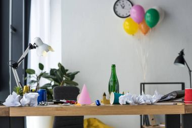 party decorations, bottle of champagne and balloons in office