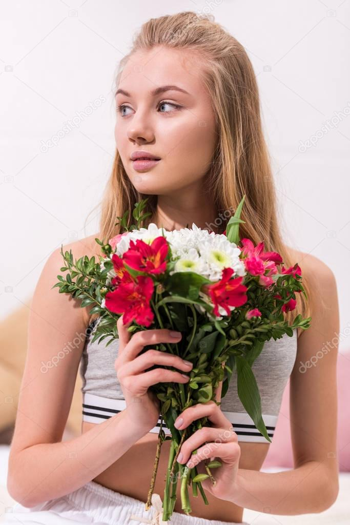 close-up portrait of young woman with beautiful bouquet