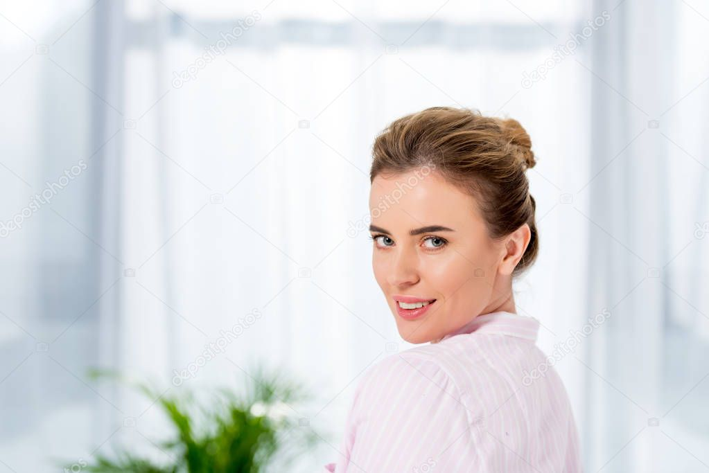 close-up portrait of attractive adult woman in pajamas