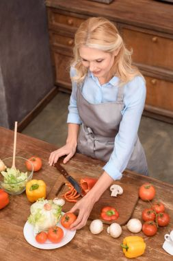 high angle view of woman preparing meal