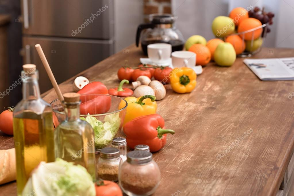 cups with coffee and vegetables with fruits on wooden table