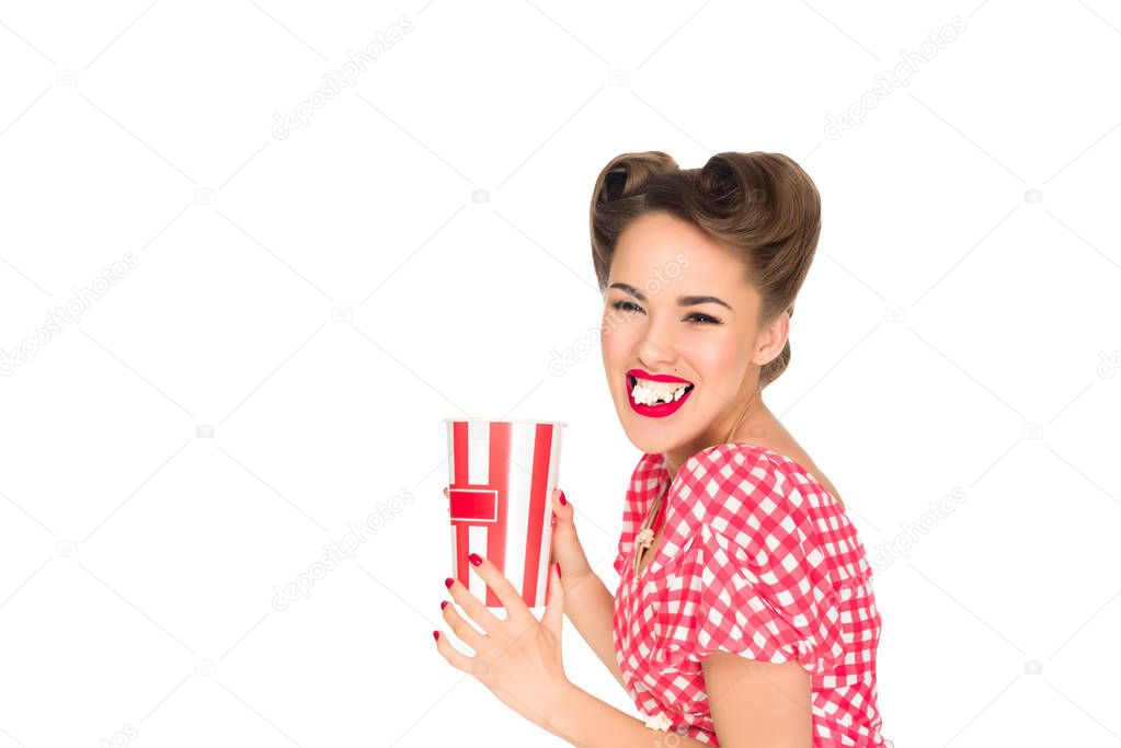 portrait of stylish young woman eating popcorn isolated on white