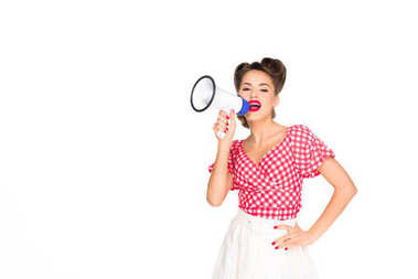 portrait of fashionable young woman in pin up style clothing with loudspeaker isolated on white