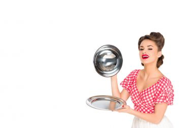 beautiful young woman in retro clothing with empty serving tray in hands isolated on white