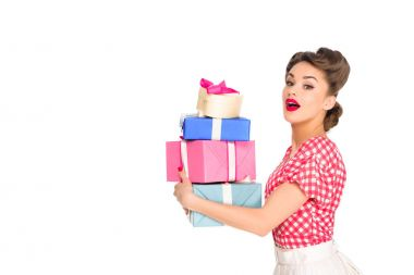 side view of beautiful woman in retro clothing holding wrapped presents isolated on white