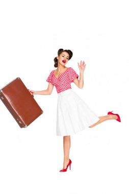 beautiful young woman in retro clothing with suitcase isolated on white