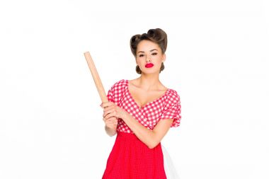 portrait of stylish woman in retro clothing and apron with rolling pin isolated on white