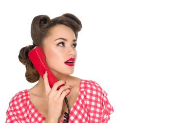 Portrait of pin up woman talking on old telephone isolated on white stock vector