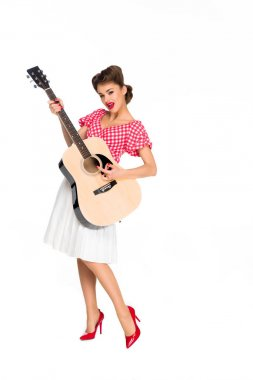 attractive young woman in retro clothing with guitar isolated on white