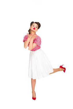 beautiful young woman in retro style clothing blowing kiss isolated on white