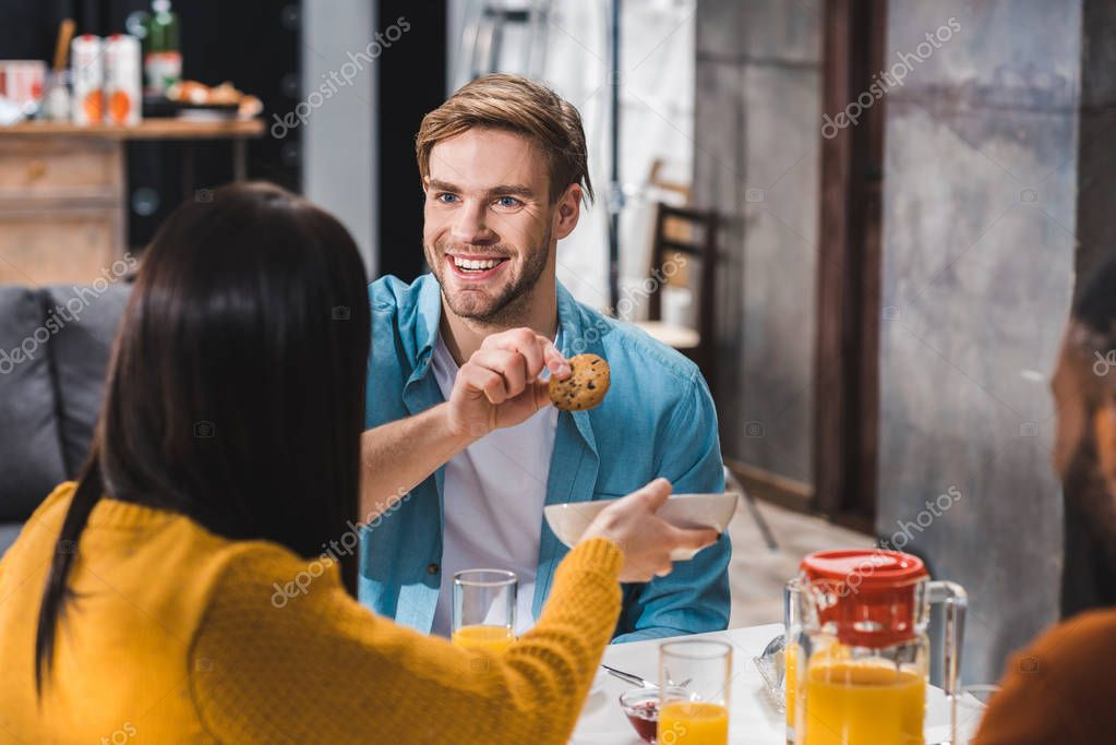selective focus of young friends having breakfast together
