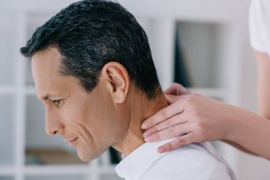 close-up shot of businessman having office massage of neck