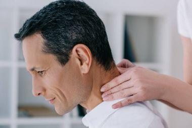 close-up shot of businessman having office massage of neck