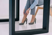 Photo cropped shot of businesswoman with pain in ankle