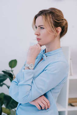 attractive thoughtful businesswoman looking away