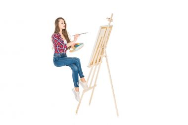 Young woman levitating and painting on easel isolated on white stock vector