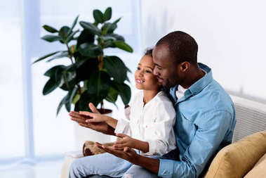 happy african american father and daughter having fun at home