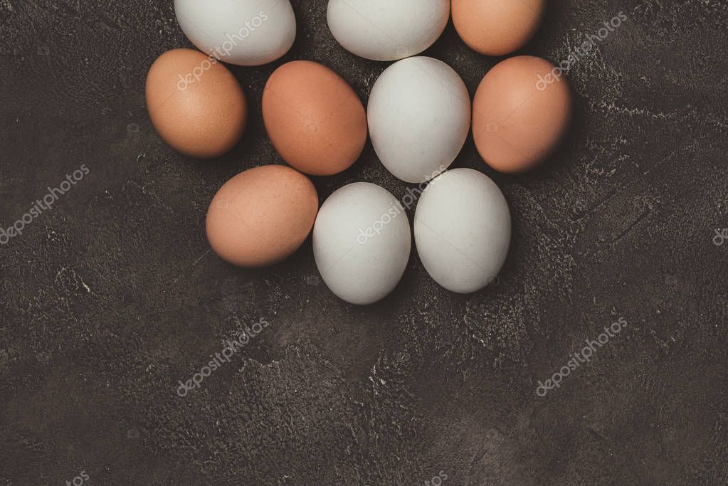 top view of white and brown chicken eggs on table