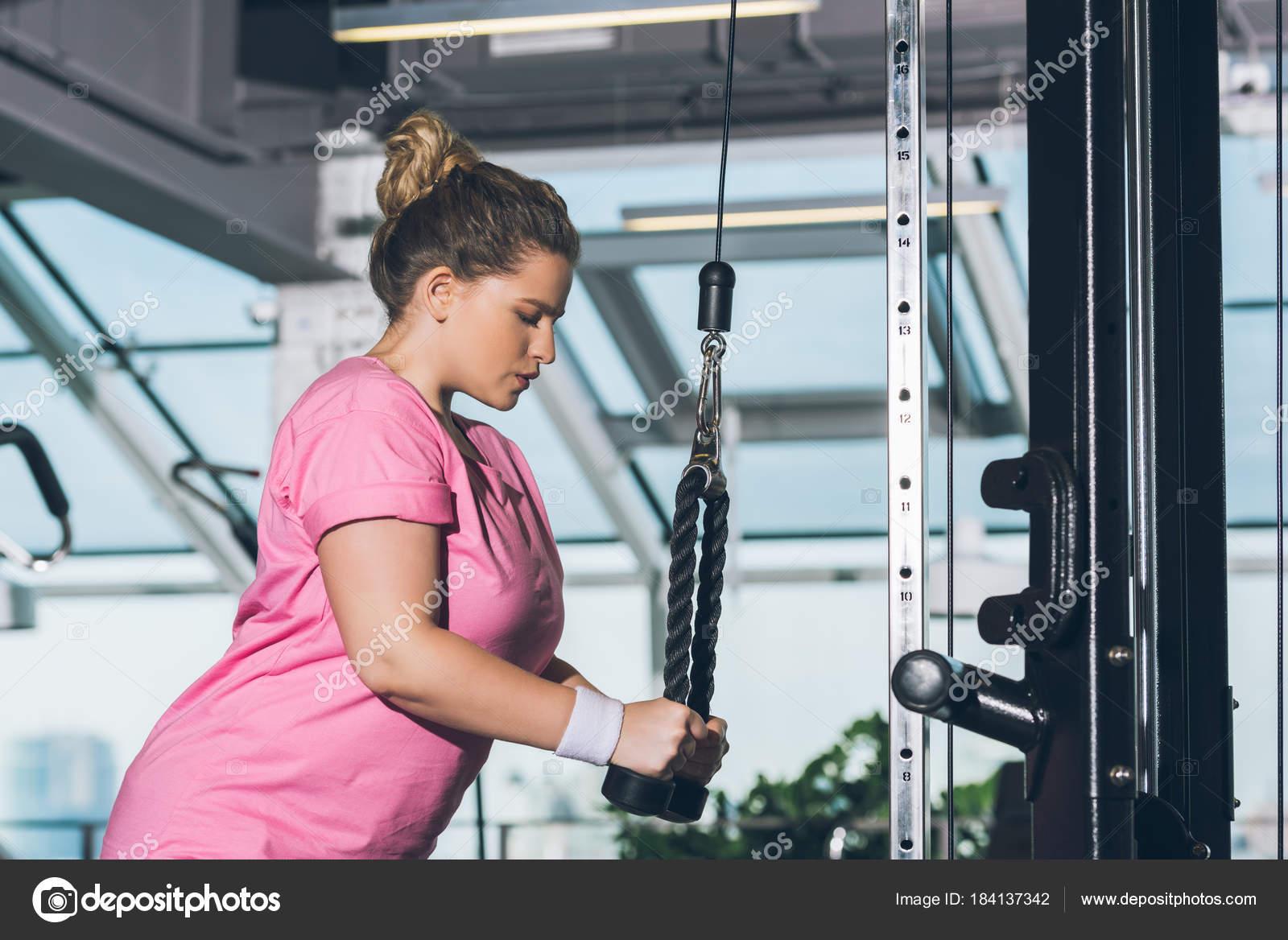 Overweight Woman Working Out Training Apparatus Stock Photo C Igorvetushko 184137342