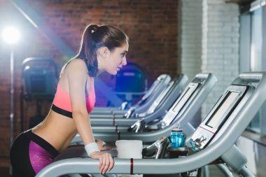 sporty woman training on treadmill