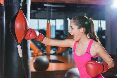 active sporty woman doing boxing training at gym