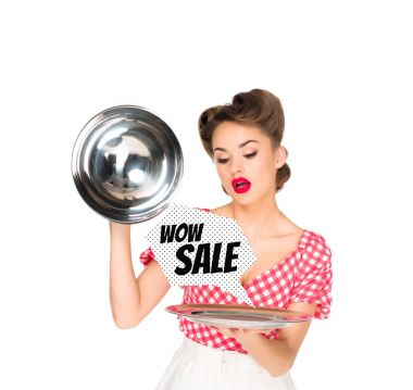 Beautiful young woman in retro clothing with sale speech bubble on serving tray in hands isolated on white stock vector
