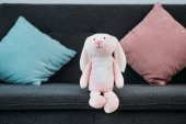 close up view of pink childish toy on sofa