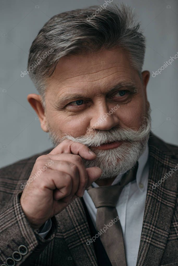 close-up portrait of stylish senior man with grey beard