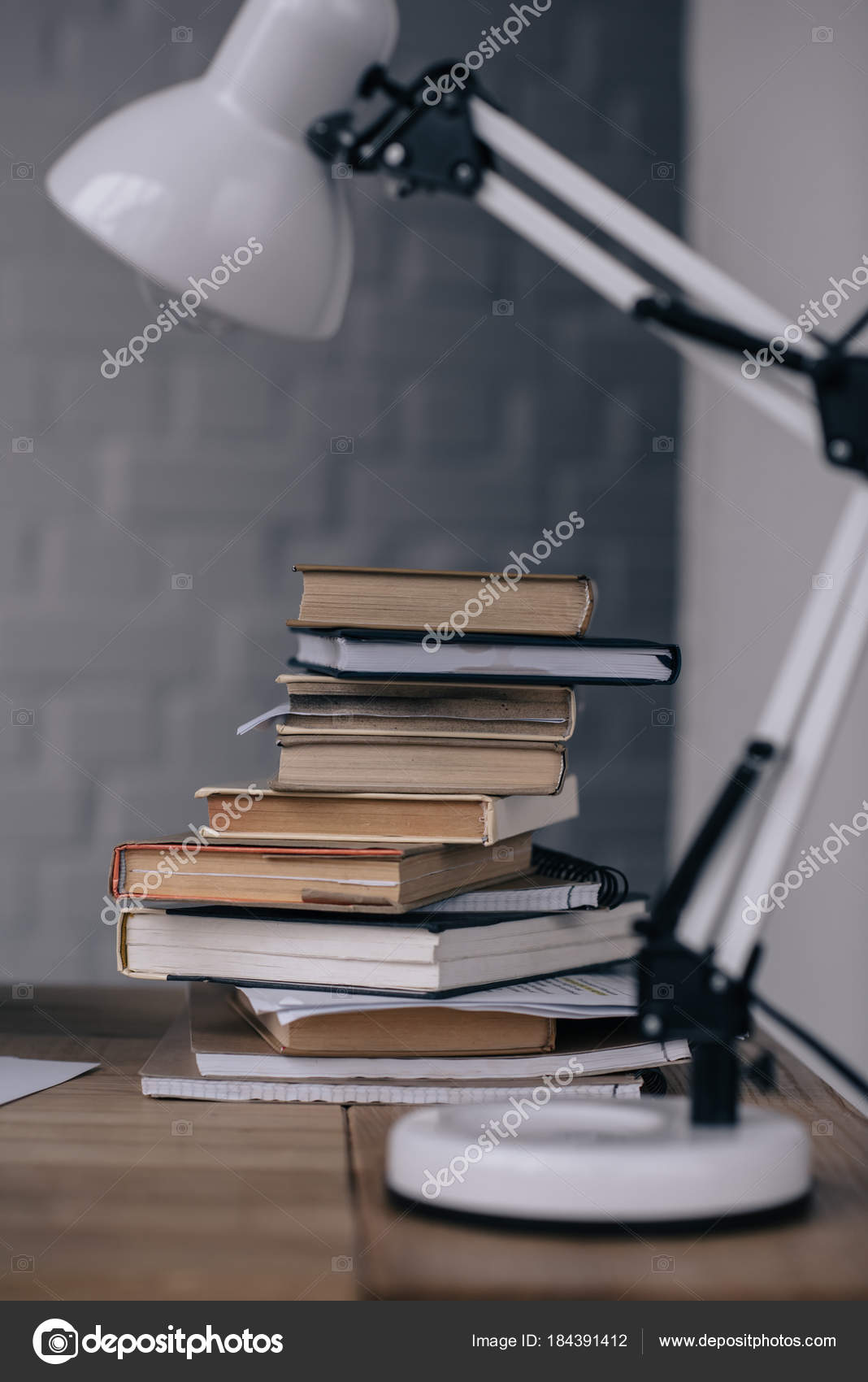Close shot stacked books table lamp work desk stock photo close shot stacked books table lamp work desk stock photo aloadofball Image collections