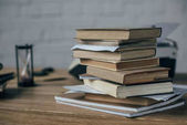 close-up shot of stacked books on work desk