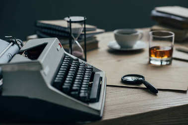 close-up shot of writer workplace with typewriter