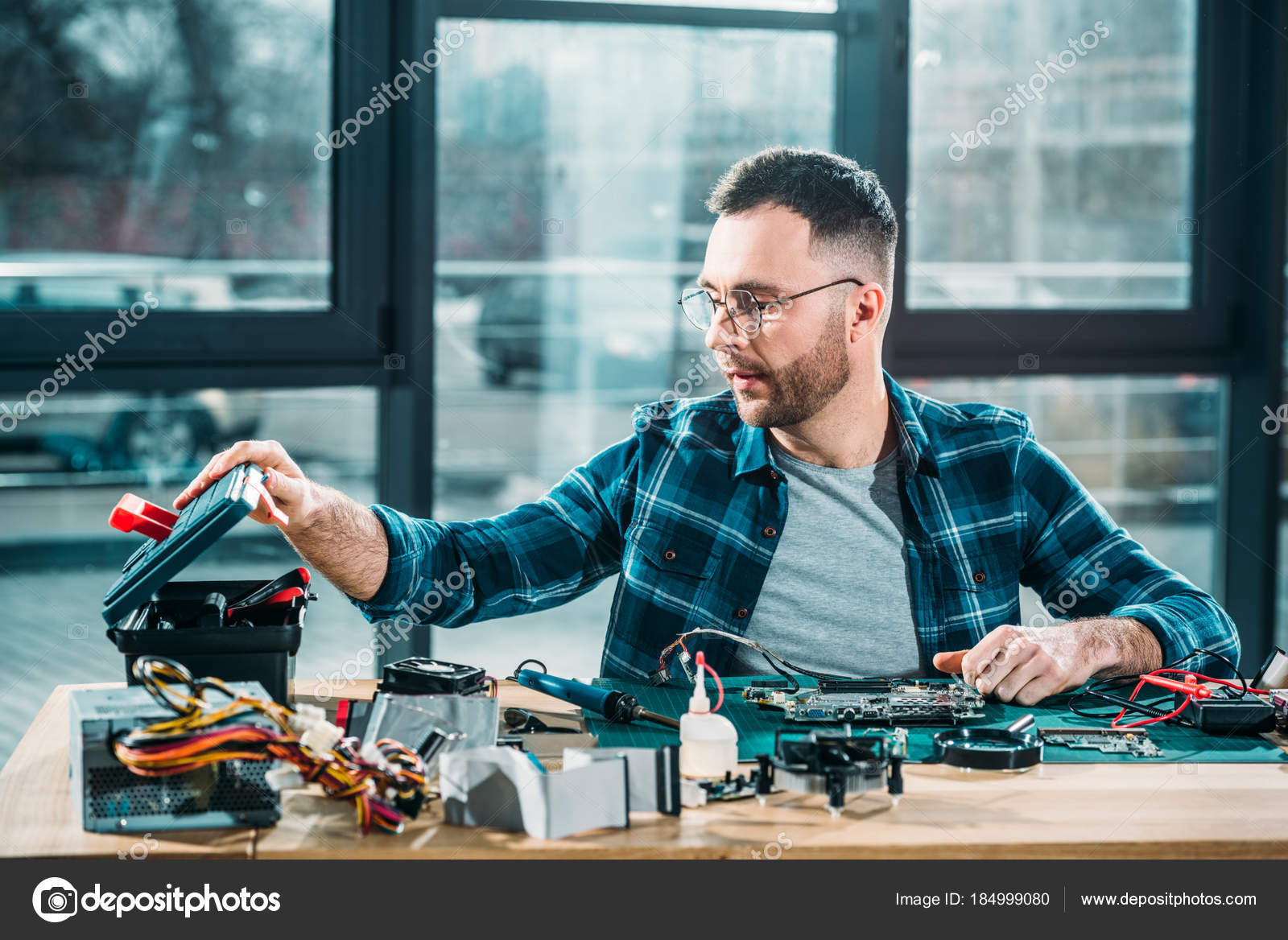 hardware engineer instruments circuit board workplace stock photo
