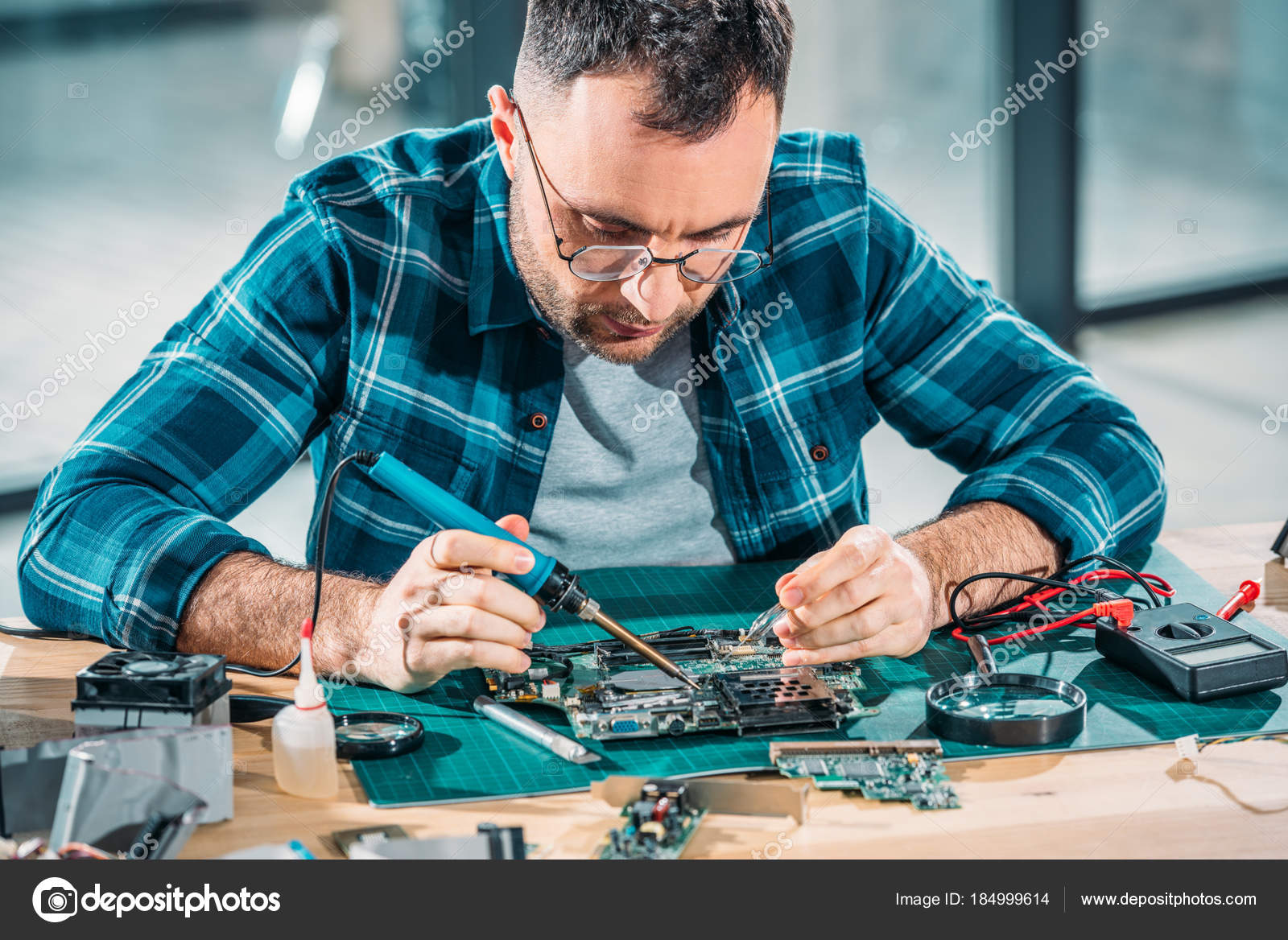hardware engineer glasses soldering parts stock photo