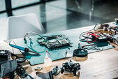 Photo Engineer workplace with circuit board and soldering equipment
