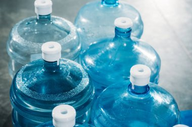 Rows of plastic blue water bottles