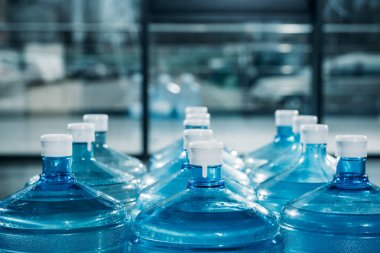 Rows of large blue water bottles