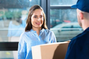 Delivery man giving woman package