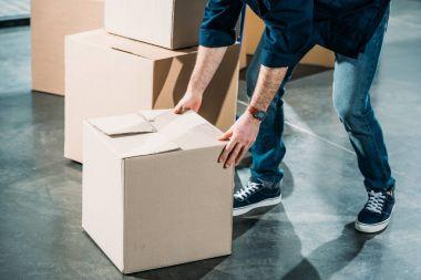 Loader man lifting cardboard box
